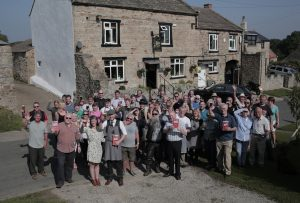 The landlord, regulars and CAMRA members celebrate at the George and Dragon in Hudswell. Picture by Stuart Boulton.